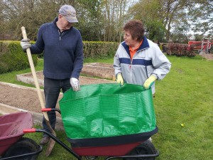 Attaching the wheel barrow booster to triple the capacity of the wheelbarrow