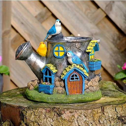 Fairy Dust watering can design planter with window and door features