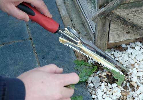 Dirt Buddy garden tool is a pointed fork shaped trowel ideal for weeding