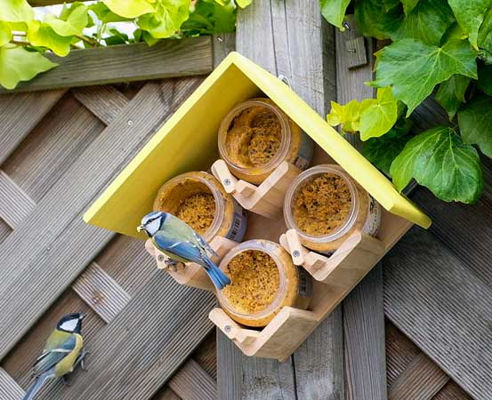 4 Peanut butter bird food jar feeder with yellow roof