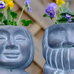 Stone-effect husband and wife gnome planters. Fill them with the plants of your choice.