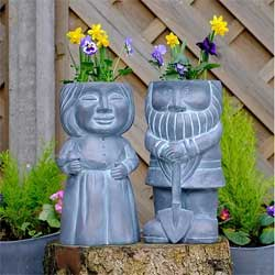 Stone-effect husband and wife gnome planters.