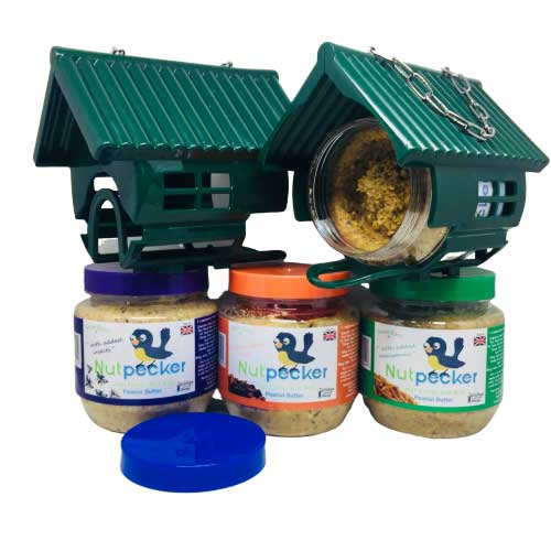 NutPecker Bird Feeder Houses and 4 jars of peanut butter food jars