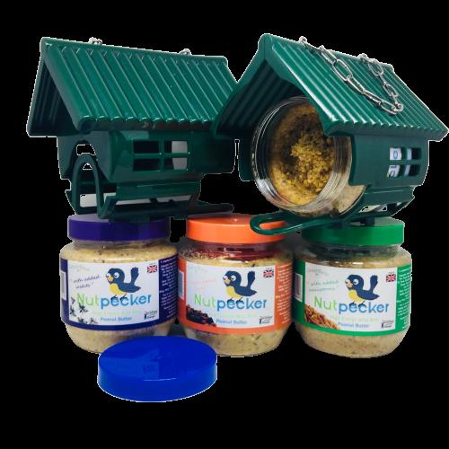 2 NutPecker bird feeder houses and 4 jars of peanut butter mix bird food