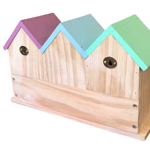 Terraced bid houses showing the back nail hangers for easy assembly on a wall or fence