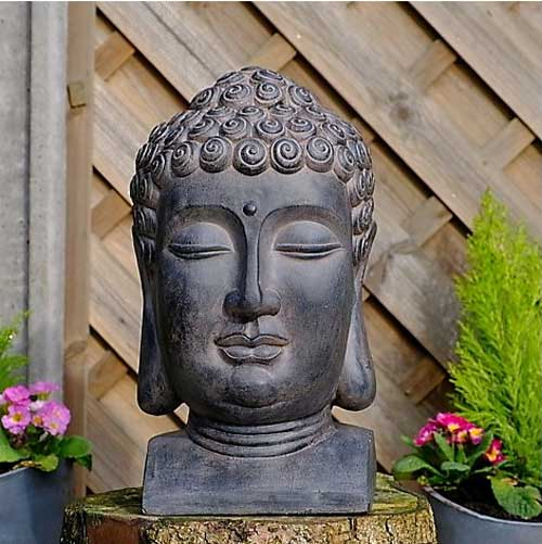 This Buddha head garden ornament will make a fascinating addition to any flowerbed, garden, or outdoor area.