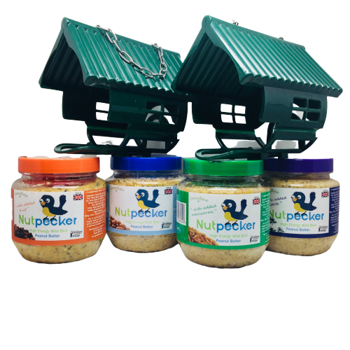 2 NutPecker bird feeders and 4 jars of peanut butter bird food jars