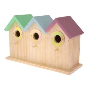 This Triple Deluxe Terraced Bird House is in the style of a row of coloured beach huts, providing three separate homes for small garden birds