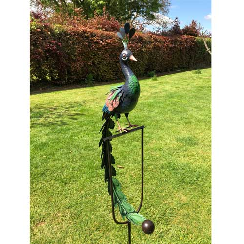 Metal garden peacock ornament that rocks in the wind