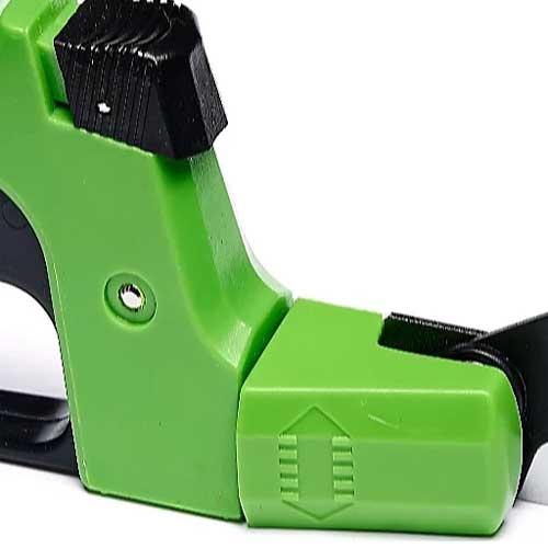 Handheld garden shears with green handle