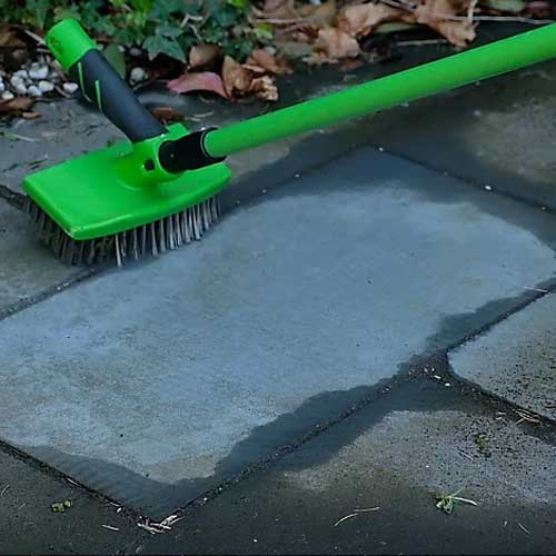Telescopic rake broom with large wire brush attached for cleaning patios