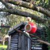 Christmas Red Bauble containing a Nutpecker peanut butter bird food jar