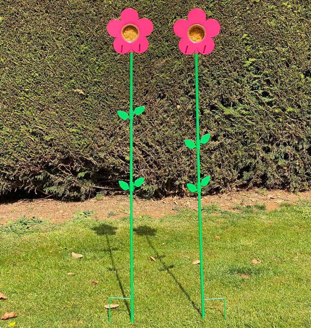 2 pink flower feeder which hold Nutpecker peanut butter jars for wild birds