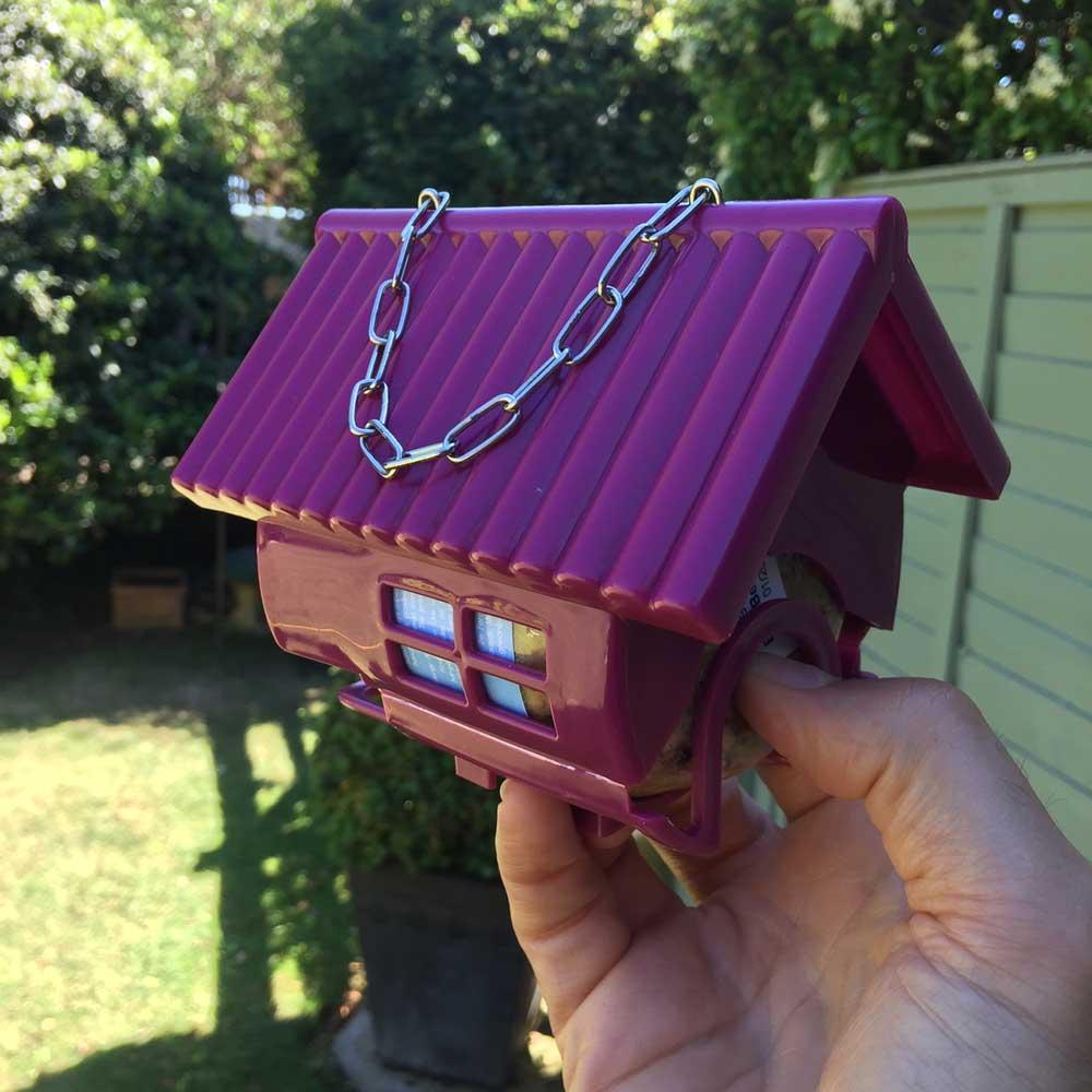 Hanging bird feeder for Nutpecker peanut butter bird food jars from the Grumpy Gardener