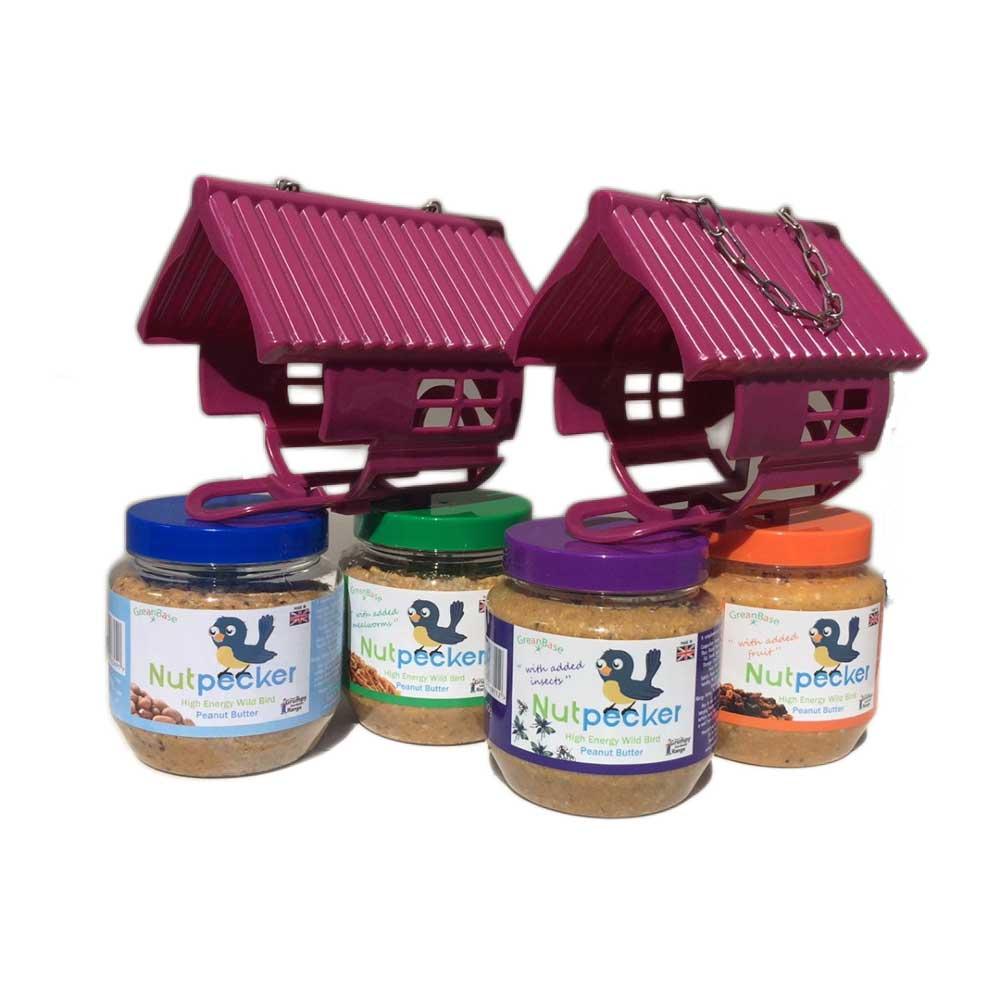 2 purple bird feeders that hold a jar of nutpecker peanut butter bird food