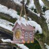 Gingerbread house that holds one jar Nutpecker bird food